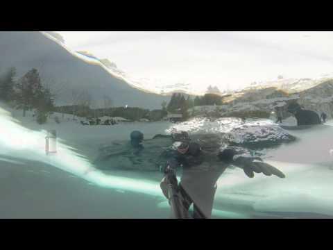 Brave diver plunges deep into frozen lake