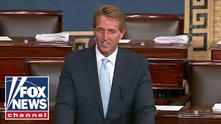 Flake threatens judicial nominations to protect Mueller