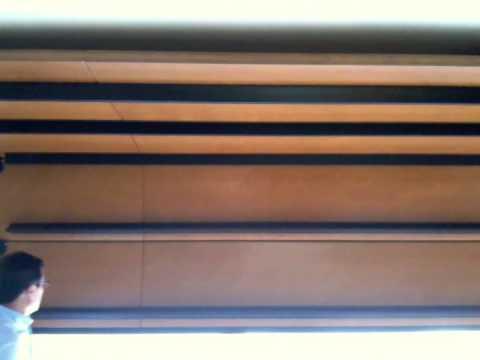 Presentazione di una porta sezionale in legno minimo - Scale minimo ingombro ...
