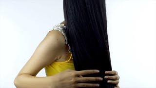 Indian female model playing with her long black tresses - hair and beauty concept