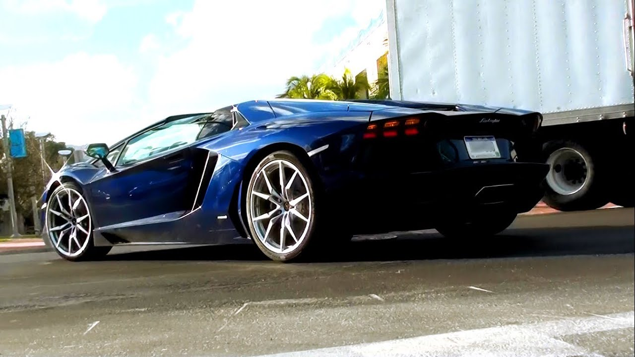 Two Dark Blue Lamborghini Aventador Lp700 4 Roadsters Driving In Miami Beach Florida Youtube