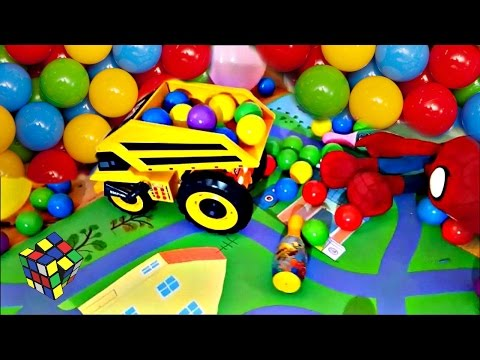 Toddlers Playing With Huge Toy Dump Truck and Plastic Colored Balls Caterpillar Toys Playtime Trucks