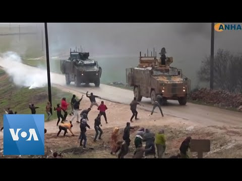 Civilians Throw Rocks At Turkish Military Convoy In Northwestern Syria
