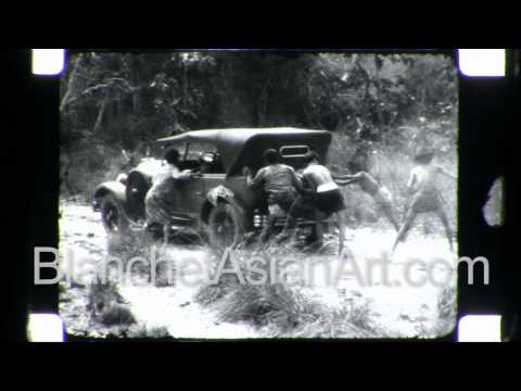 Cambodia in the 1920's: American tourists have car trouble near Angkor Wat