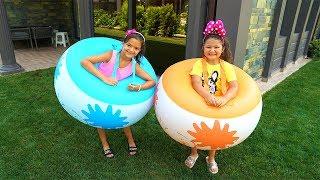 Masal and Öykü playing inflatable balls - fun video