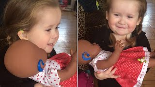 Watch as 3-Year-Old Deaf Girl Receives Doll 'Just Like Her' thumbnail