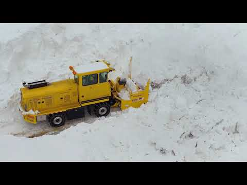 Crews clear avalanche slides from a highway more than 40 feet deep