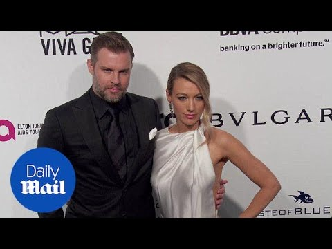 Natalie Zea and Travis Schuldt arrive at Elton John Oscar bash  Daily Mail