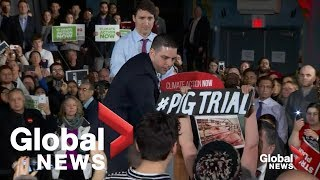 Hecklers interrupt Trudeau several times during climate rally amid SNC-Lavalin controversy