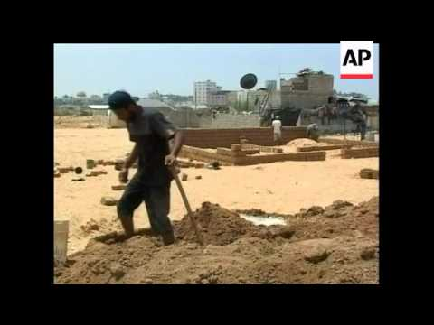 Palestinians in the southern Gaza town of Rafah have started building homes from mud bricks as no ot