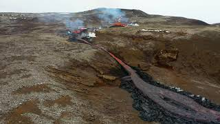 Stream of Molten Lava Flows from New Fissure At Icelandic Volcano