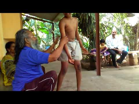 Ancient yogic Practice: Yoga Guru Yesudas training kids.