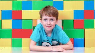 Eli makes Playhouse from building Blocks