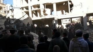 وكالة قاسيون  الدفاع المدني ينتشل جثث المدنيين من تحت الانقاض في مدينة زملكا بريف دمشق 6-12-2015