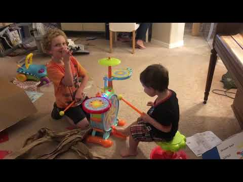 Asher plays his drum set