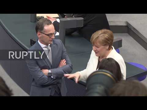 Germany: AfD supporter removed for protest during Merkel's oath-taking