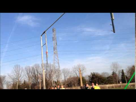 Robert Atwater pole vaulting to Lincoln Park school record at 14 feet