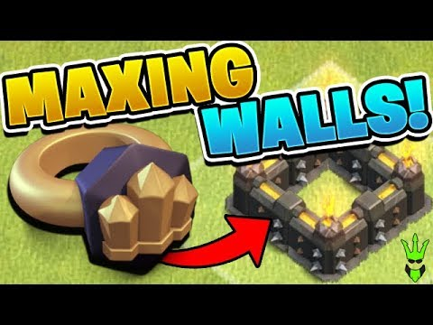 USING WALL RINGS TO MAX MY WALLS! - Clash of Clans