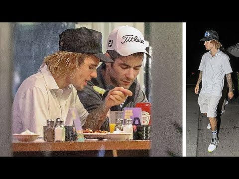EXCLUSIVE - Justin Bieber Grabs A Burger After Golf With A Pal