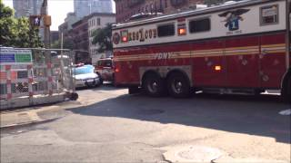 FDNY RESCUE 1, FDNY LADDER 4, FDNY ENGINE 54, FDNY EMS BATTALION 975 ON SCENE OF MVA ON W. 48TH ST