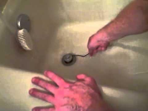unclogging-a-tub