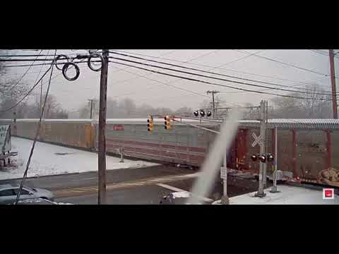 Freight train moving slow in the snow on big trains tv.
