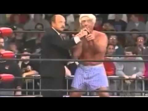 ric flair throws a pair of gucci shoes at wrestling crowd