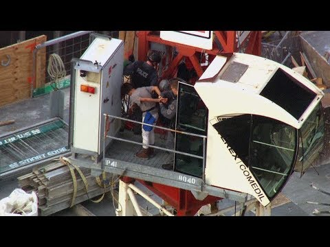 High-angle arrest after woman climbs crane in Toronto