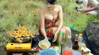 Primitive Beautiful Girl Cooking Fish On The River
