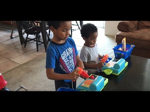 Kids Grocery Shopping with a toy cart and Cashier Register