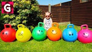 Gaby jumping on colorfull skippy balls