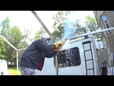 Tiny Off Grid Boat Camper 7 - Outboards and Aluminum welding.