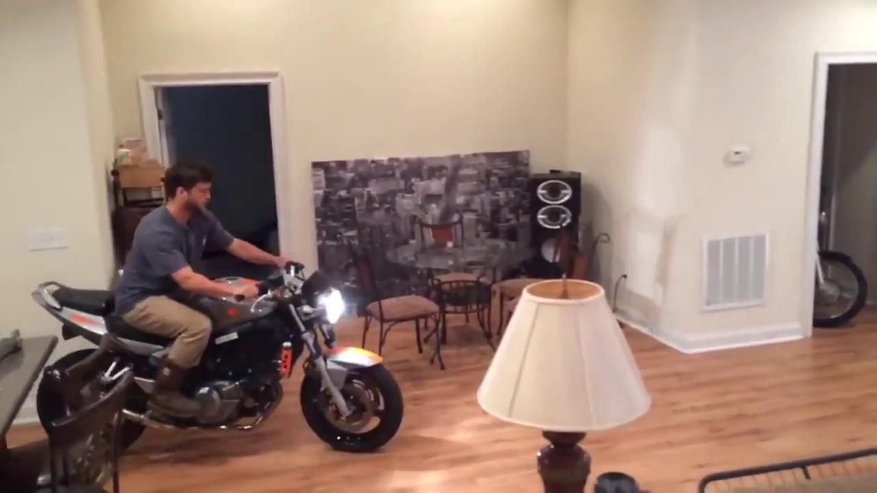 Ultimate wheelie fail. Man crashes motorcycle in living room