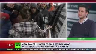 Man spends 22 hours in car protesting against towing away