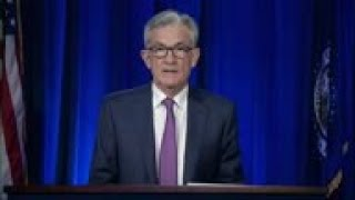 Fed sees dim outlook as virus squeezes economy