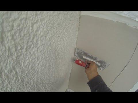 Fassade Verputzen mit fein putz aufziehen und abfilzen. nach der Gewebearmierung