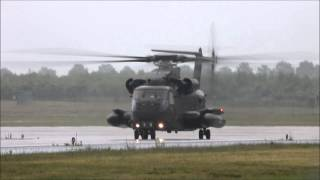 Sikorsky CH-53 helicopter landing during heavy rain at Geilenkirchen (HD)