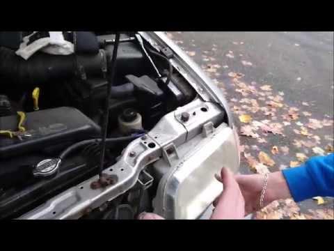 Replace Burnt Out Headlight Bulb On A 2002 Kia Sedona A