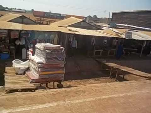 Uganda  South Sudan  Money changers and shops at the Nimule border  2016