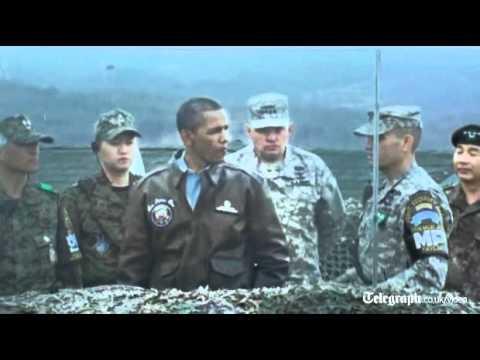 US President Barack Obama peers across South Korea's border