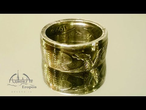A ring of coins with the eagle tech DIY Ring out of a Coin
