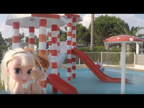 Elsa and Anna toddlers fun at the water park swimming pool fun & slides with Ariel