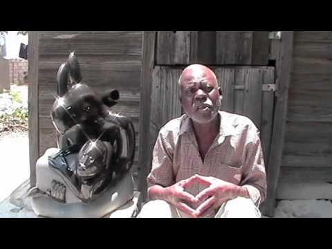 "http://www.guruve.com Shona sculpture ""Spirit Rhino"" by Zimbabwean artist Sylvester Mubayi.m4v"