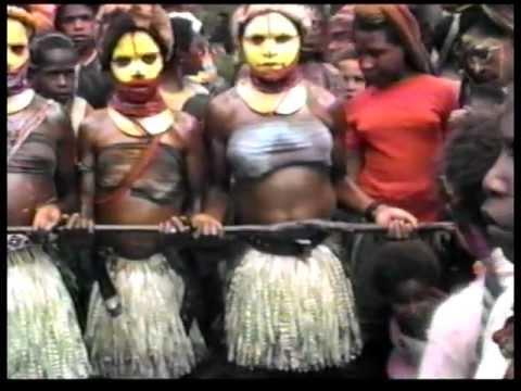 Papua New Guinea - Huli girls Traiditional Mali dance - Village of Pureni