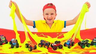 Vlad y Nikita juegan con camiones monstruo de juguete  Coches Hot Wheels para niños
