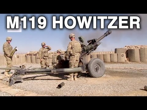 U.S. Army 1-76 FA Soldiers Fires M119 Howitzer