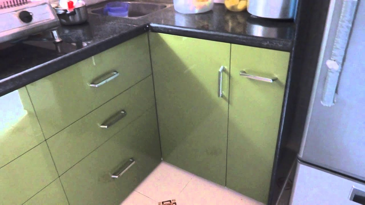 "Modular kitchen in ""olive green""colour in polymer range in"
