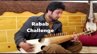 amjad malang rabab open challenge to izhar rabab master by playing rabab with marker
