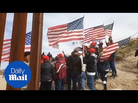 Demonstrators form a 'human wall' to protest at the border