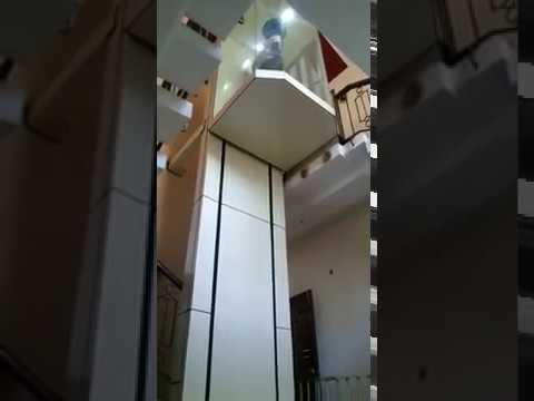 Hydraulic capsule elevator inside home for Small elevator for house